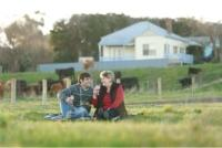 romantic couple having picnic at lake purrumbete